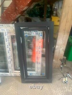 Brand New Upvc Window anthracite grey /white 590 W x 1140 fully glazed t&t