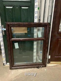 Brand new upvc rosewood window fully glazed 975 W x 1200 h bottom opener