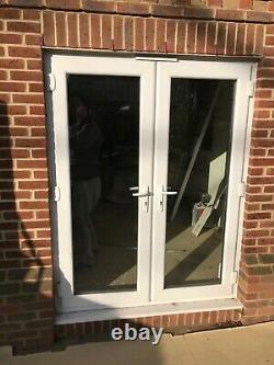 White UPVC Double Glazed Doors One set, but two available Can Deliver